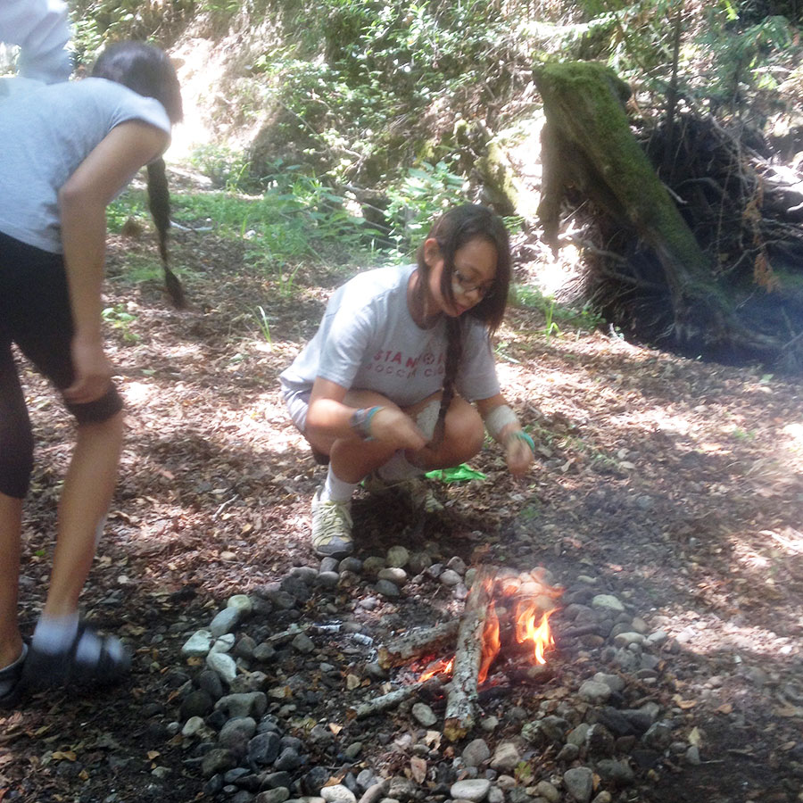 learning to build a fire at camp