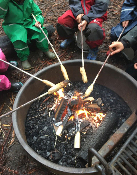 making stick bread over a fire